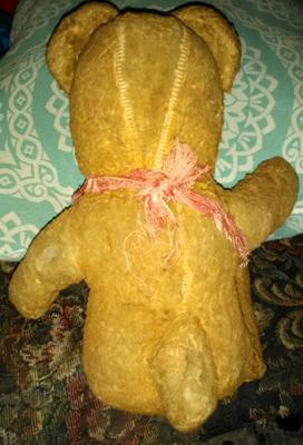 back view of old teddy bear