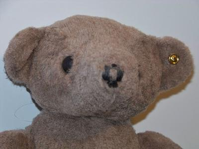 Jointed bear with button in ear