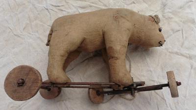 side view of bear on wheels