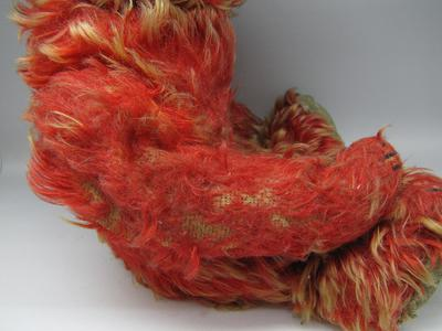 Very threadbare red teddy bear
