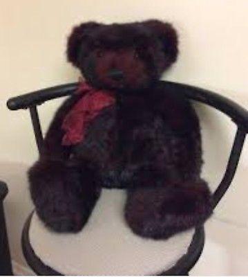 Gund teddy bear sitting in chair