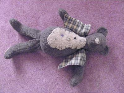front view of old grey teddy bear
