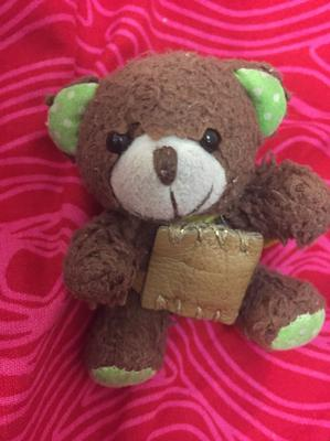 small teddy bear with green ears