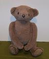 Jointed bear with button