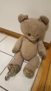 Tatty teddy bear needs repair
