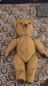50 Year Old Teddy Bear laying down