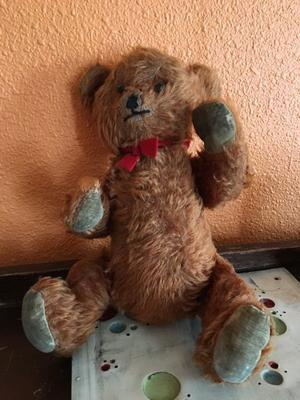 old bear with movable arms and legs