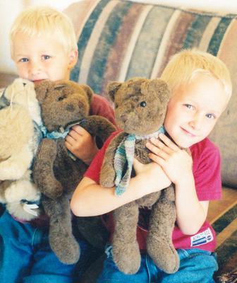 Twins with their teddy bears
