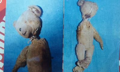 two very old and damaged teddy bears