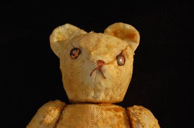 close up of old teddy bear