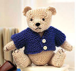 teddy with blue knitted coat
