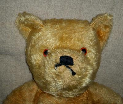 face of old teddy bear
